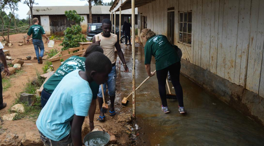 Some teaching volunteers help staff from a local school in Kenya to clean the facilities during their projects with Projects Abroad.